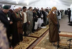 Gaddafi during prayer on February 13, 2011